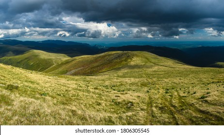Stromy clouds over the alpine grassland of the Ursu Peak, Capatanii Mountains, Romania - Shutterstock ID 1806305545