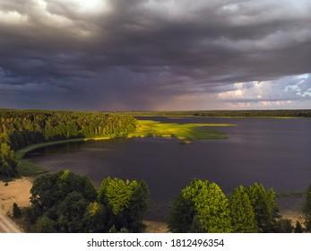 Stromy clouds over eautful peninsula between lakes Snudy and Strusto, National Park Braslau Lakes, Belarus. - Shutterstock ID 1812496354