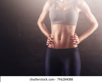 Strong abdominal muscles of sporty woman