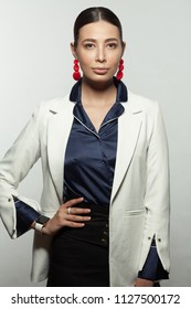 Strong, active, modern, successful fashionable business woman in white trendy jacket waiting for appointment. Studio shot