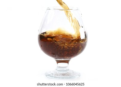 strong alcohol is poured into a glass for consumption