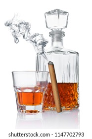 Strong alcoholic drink cognac in old fashion glass and crystal decanter with smoking cigar isolated on white background