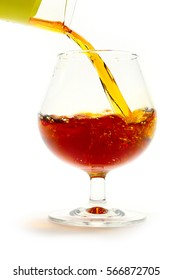 strong alcoholic drink containing alcohol is poured into a glass for consumption food