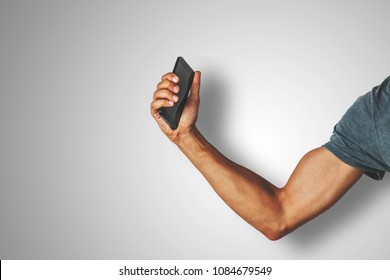 strong arm holding a smart phone