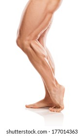 Strong Athletic Man Fitness Model Torso showing naked muscular legs isolated on white background