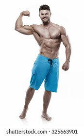 Strong Athletic Man Fitness Model Torso showing big muscles isolated over white background