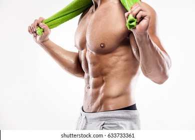 Strong Athletic Man Fitness Model Torso showing six pack abs. holding towel