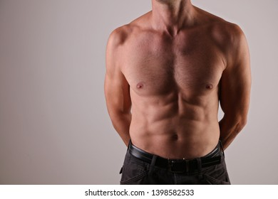 Strong Athletic Man muscular body, torso, and six pack abs close up, copy space
