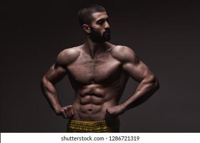 strong athletic man on dark grey gradient background