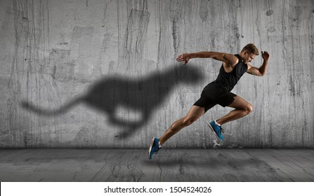 Strong athletic man sprinter, running on dark wall background wearing in sportswear. Sport and fitness motivation