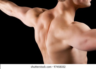 strong athletic muscle man, sports guy showing his muscles male back isolated on black background