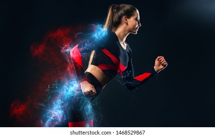 Strong athletic woman sprinter, running on black background wearing in the sportswear and headphones. Fitness and sport motivation. Runner concept.