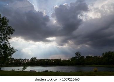 Strong beams of light shine through billowing storm clouds to form a biblical spectacle in the sky.
