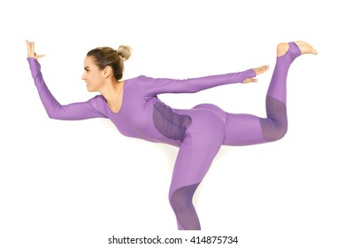 Strong body. Cropped studio shot of a young fitness woman practicing yoga balancing on one leg isolated on white