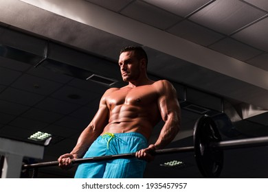 Strong bodybuilder in gym. Training and workouts. Workout exercises. Sproty sport man with naked torso and athletic body