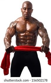 Strong bodybuilder man with perfect abs, shoulders,biceps, triceps and chest holding a red towel. Isolated on white background