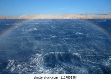 Strong bora winds causing high waves and rainbow on the level of Adriatic sea in Croatia