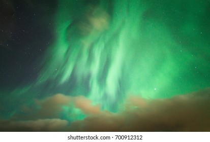 The strong bright Aurora borealis (Northern lights) over the sky in Iceland.