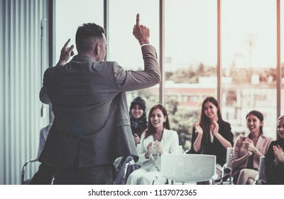 Strong Business Manager giving powerful conference