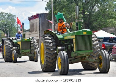 Strong City Kansas, USA, June 5, 2021 Local farmers drive their John Deere tractors in the annual Flint Hills Rodeo parade in Strong City at the conclusion of the weekends rodeo. n Strong City.
