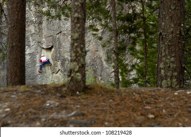 Strong climber on the cliff