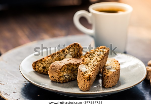 Strong coffee served with italian almond cookies cantucci