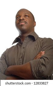 Strong and confident man looking away with crossed arms