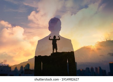 Strong, confident man on a mountain facing the city. Business success, inner strength concept.