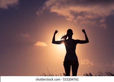 Strong and confident woman flexing her muscle. Woman power!