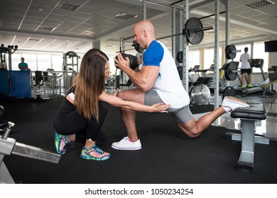 Strong Couple In The Gym And Exercising Quadriceps And Glutes With Dumbbell - Muscular Athletic Female and Male Fitness Model Exercise