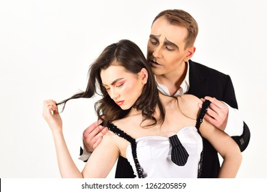 Strong emotional bonds. Couple of mime artists perform romantic scene. Sexy couple in love with mime makeup. Mime man hug woman with love emotions. Theatre actors miming through body motions.