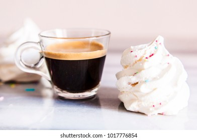 Strong espresso coffee with meringue biscuits, breakfast concept, copy space