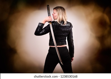 Strong female fighter with samurai sword in action