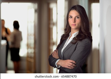 Strong female lawyer standing confident at office firm looking tough resilient with pride for justice