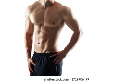 Strong, fit and sporty bodybuilder man over white background. Sport and fitness.