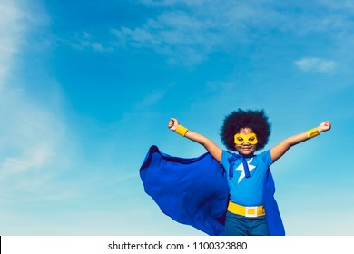 Strong girl in blue superhero outfit