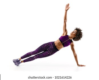 Strong girl doing fitness plank position exercises. Photo of african girl in silhouette on white background. Fitness and healthy lifestyle concept