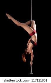 strong girl show gymnastic exercise in pole dance