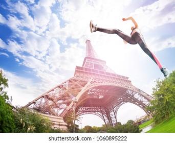 Strong girl training near Eiffel Tower