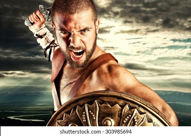 strong gladiator isolated in dark background