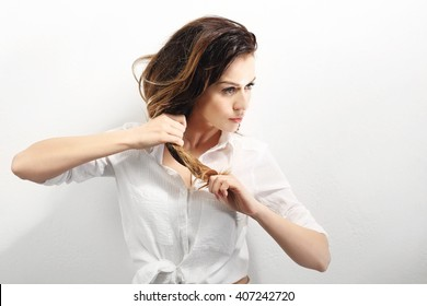 Strong hair.Portrait of a woman with beautiful long hair on a white background