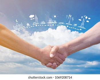 Strong handshake on blue sky with clouds background and travel map