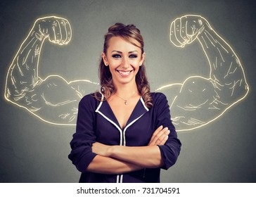 Strong happy woman on gray background