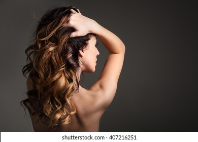 Strong healthy hair.. Portrait of a woman with beautiful long hair on a black background