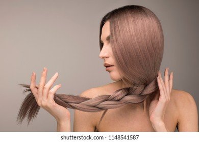 Strong and healthy long purple hair. Studio horizontal shot.