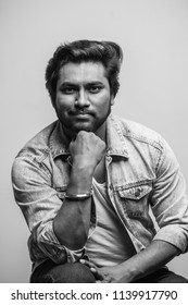 strong indian guy with pleasant appearance posing to the camera. black and white photo