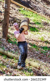 strong man carrying a tree trunk