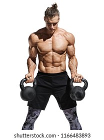 Strong man doing exercises with kettlebells at biceps. Photo of young man with good physique isolated on white background. Strength and motivation.