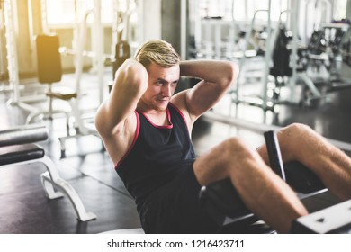 Strong man doing situp or crunches in gym,Men exercise muscular his stomach
