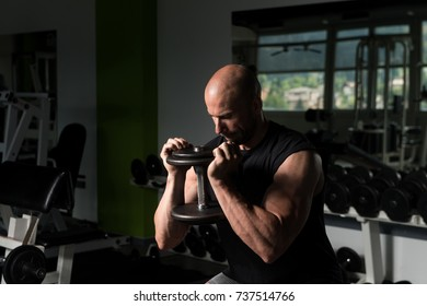 Strong Man In The Gym Exercising Quadriceps And Glutes With Dumbbells - Muscular Athletic Bodybuilder Fitness Model Exercise